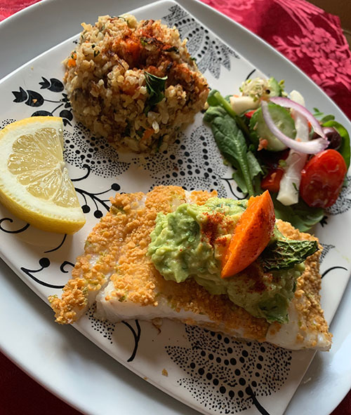 Cauliflower fried rice and lime cumin haddock with avocado salsa