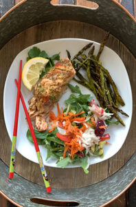 hot and sweet salmon with prebiotic salad and roasted asparagus